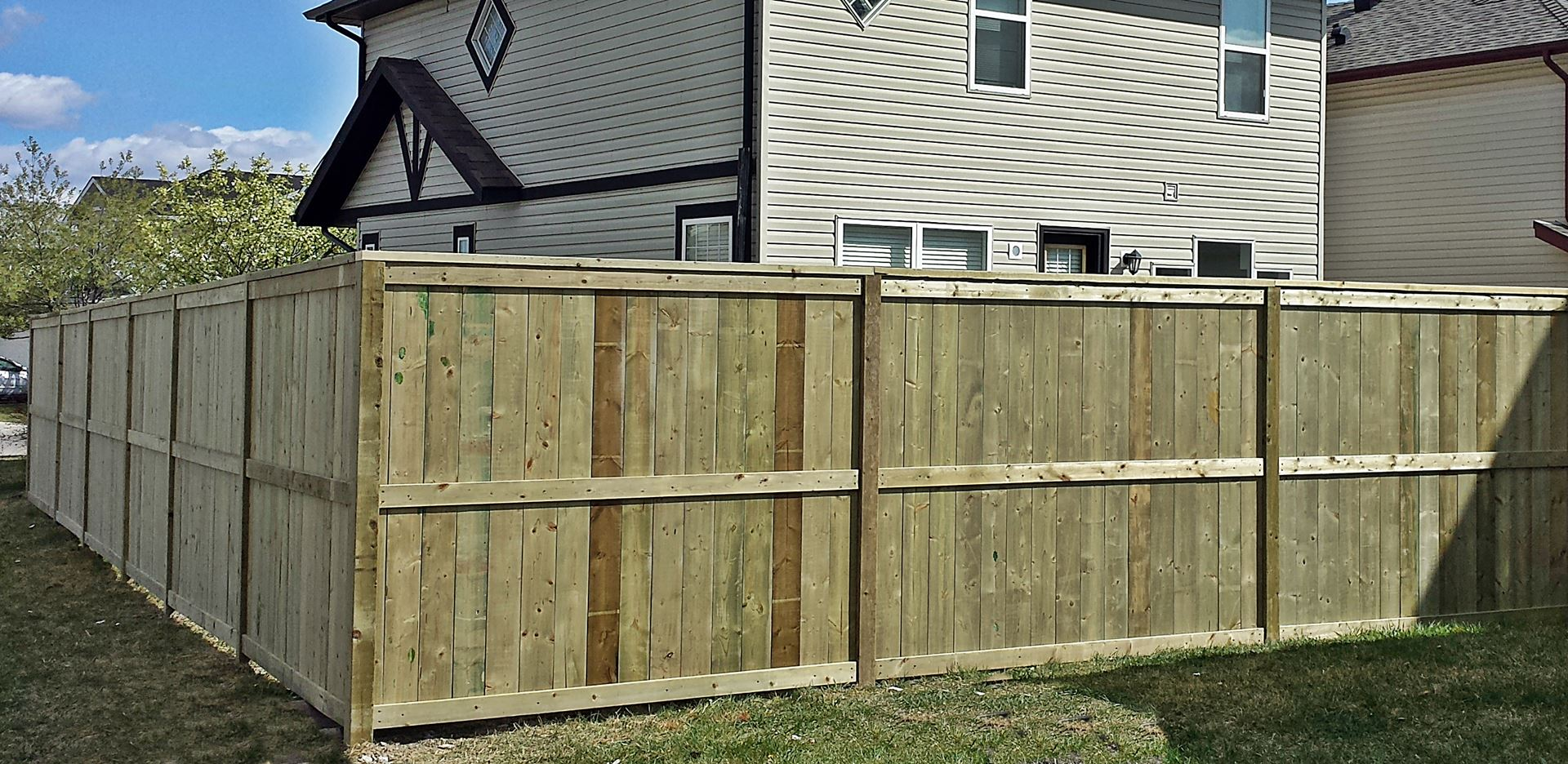pressure treated wood fence
