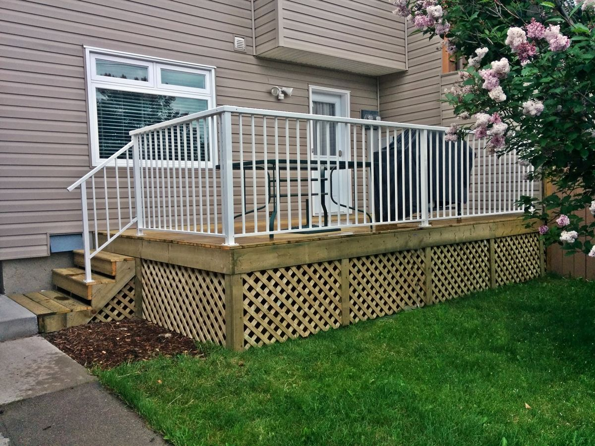 treated lattice enclosed deck white railing